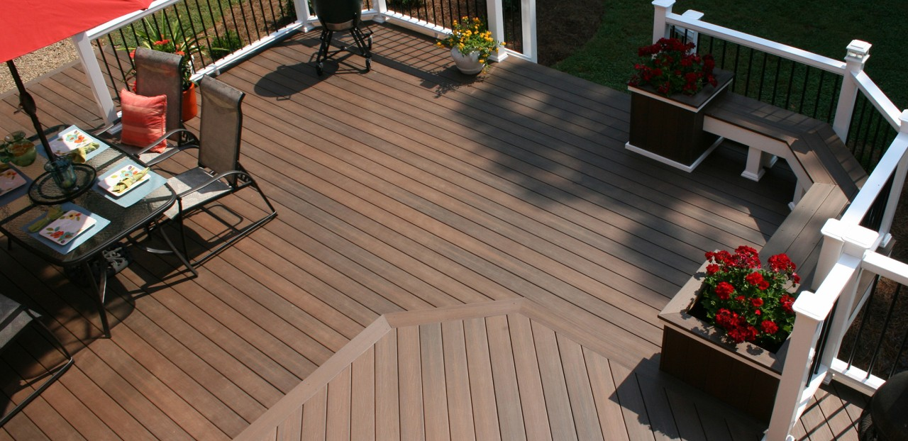 brown evergrain decking plus railing and chairs for patio design ideas