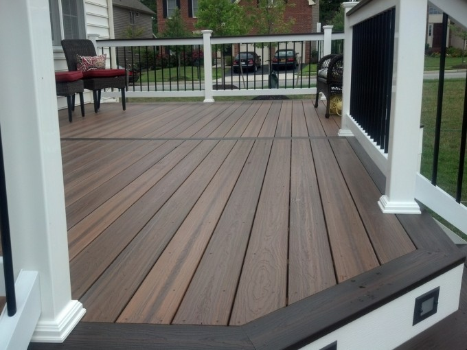 Brown Evergrain Decking Plus White And Black Railing Plus Sofa For Patio Decor Ideas