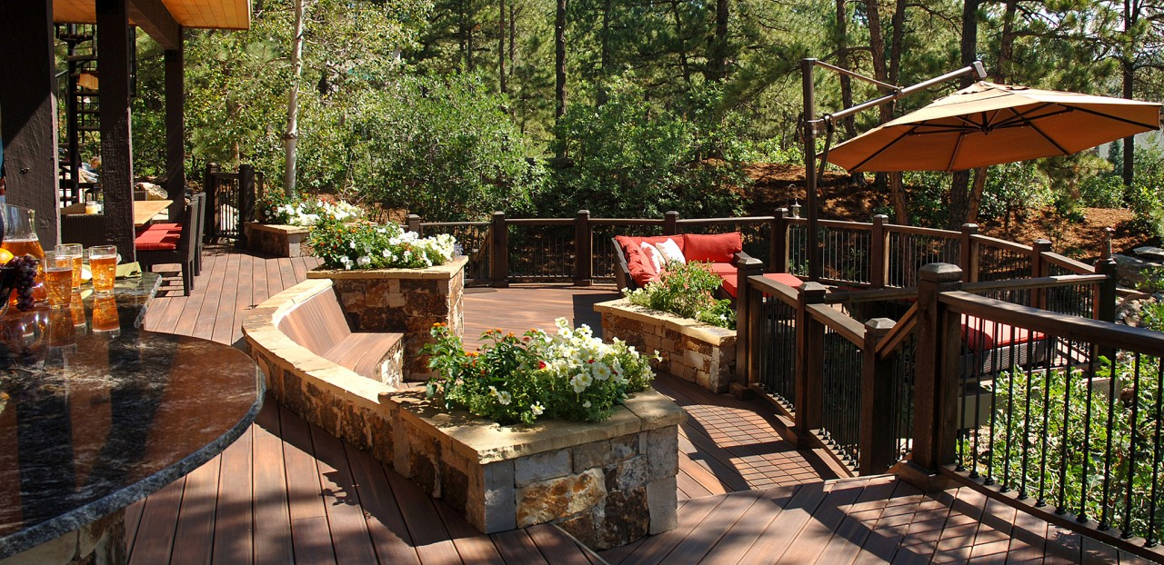 brown evergrain decking plus wooden railing and red sofa set for charming patio decor ideas