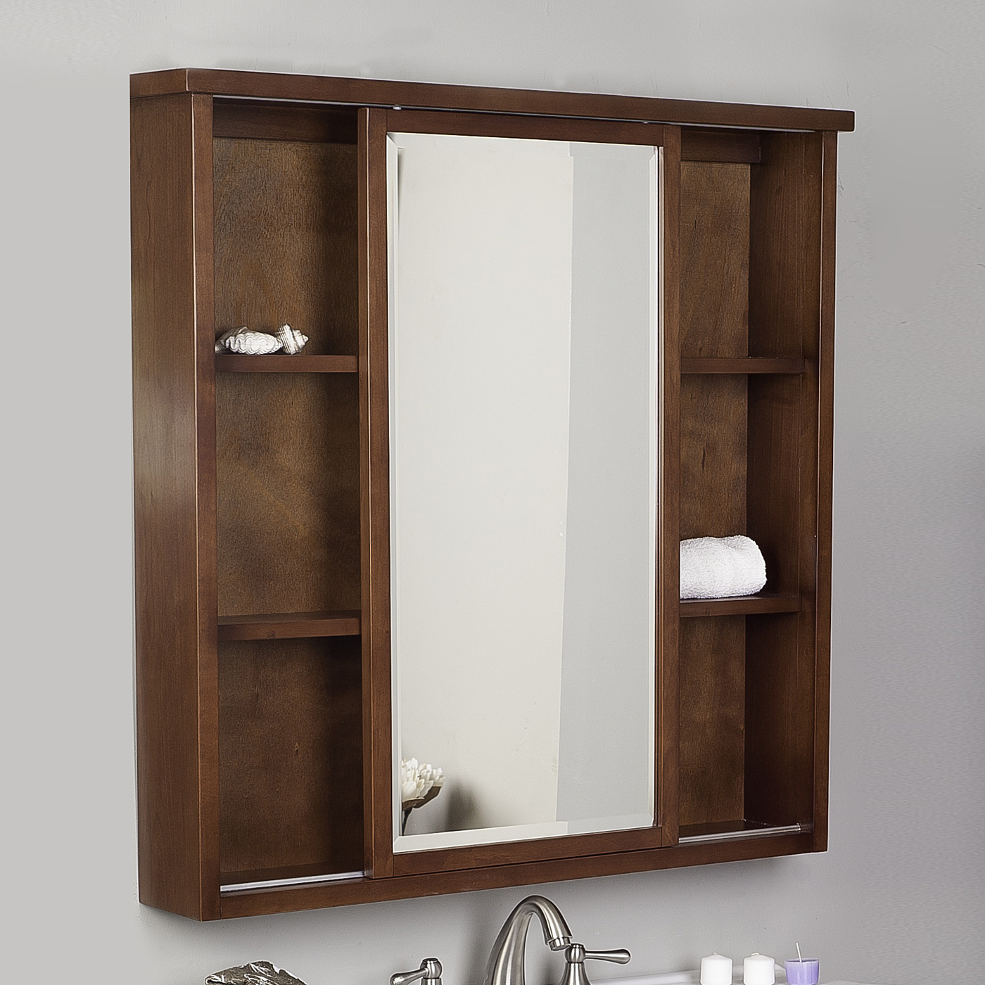 Brown Lowes Medicine Cabinets with mirror plus sink and faucet below