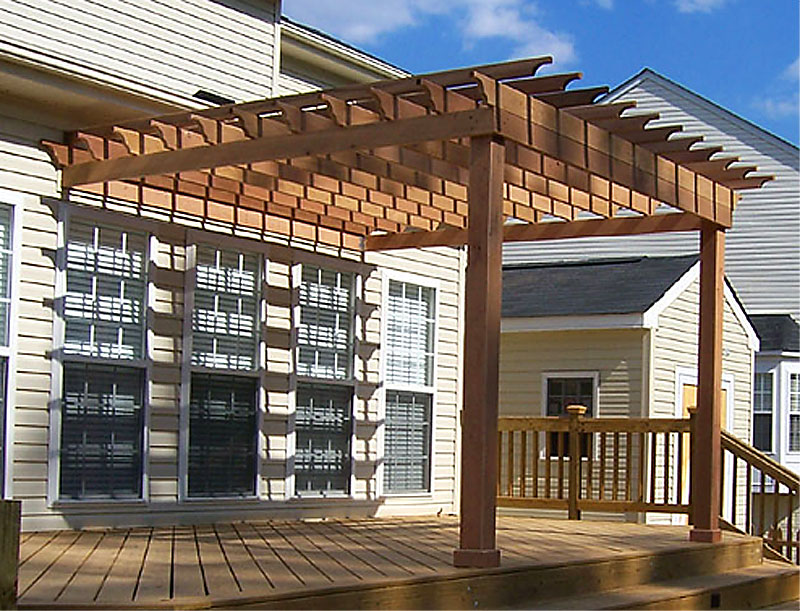 brown pergola plans on white house with single hung windows for backyard inspiration
