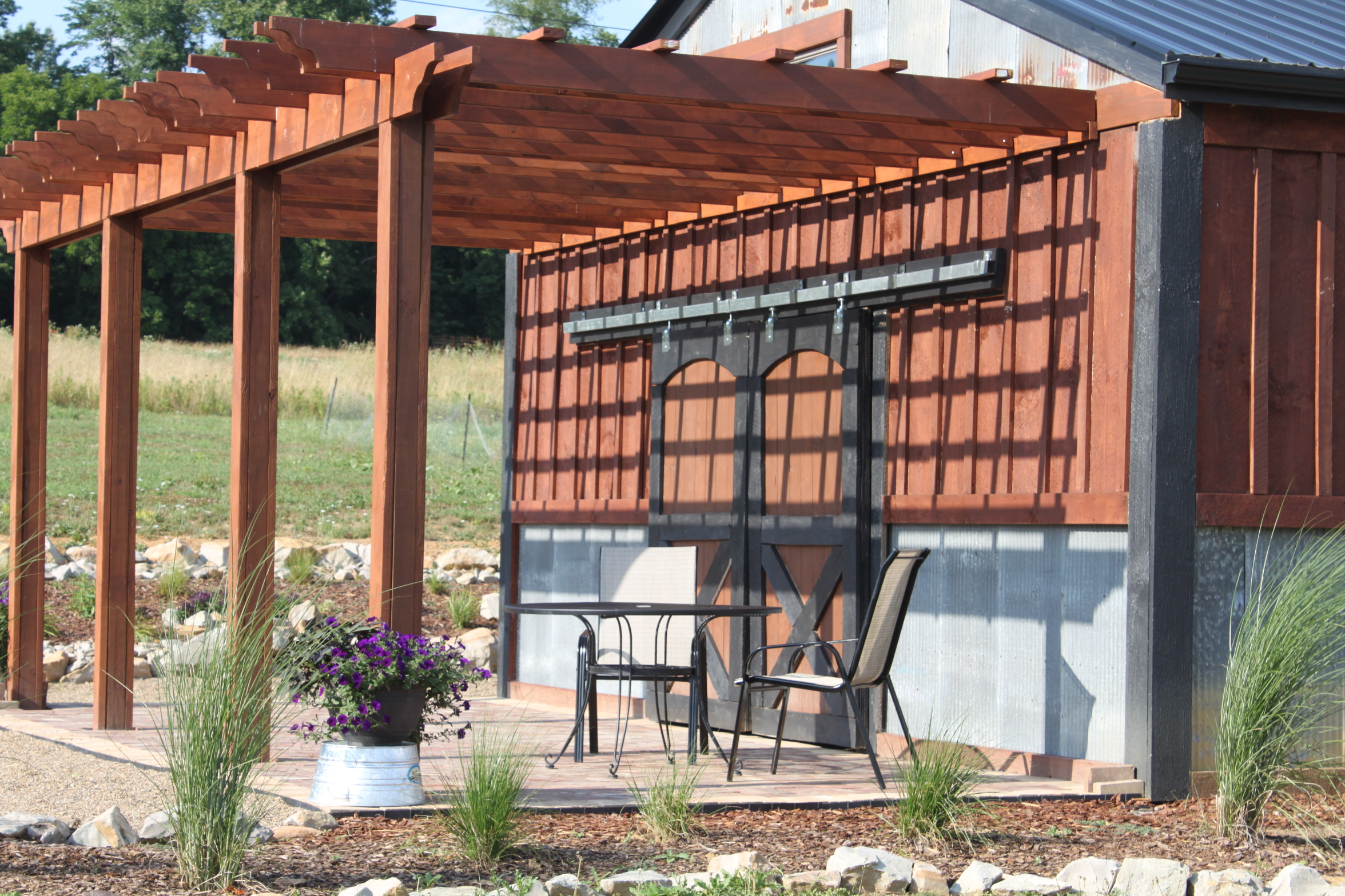 brown pergola plans with two props ideas with chair and table plus flowers for backyard decor ideas