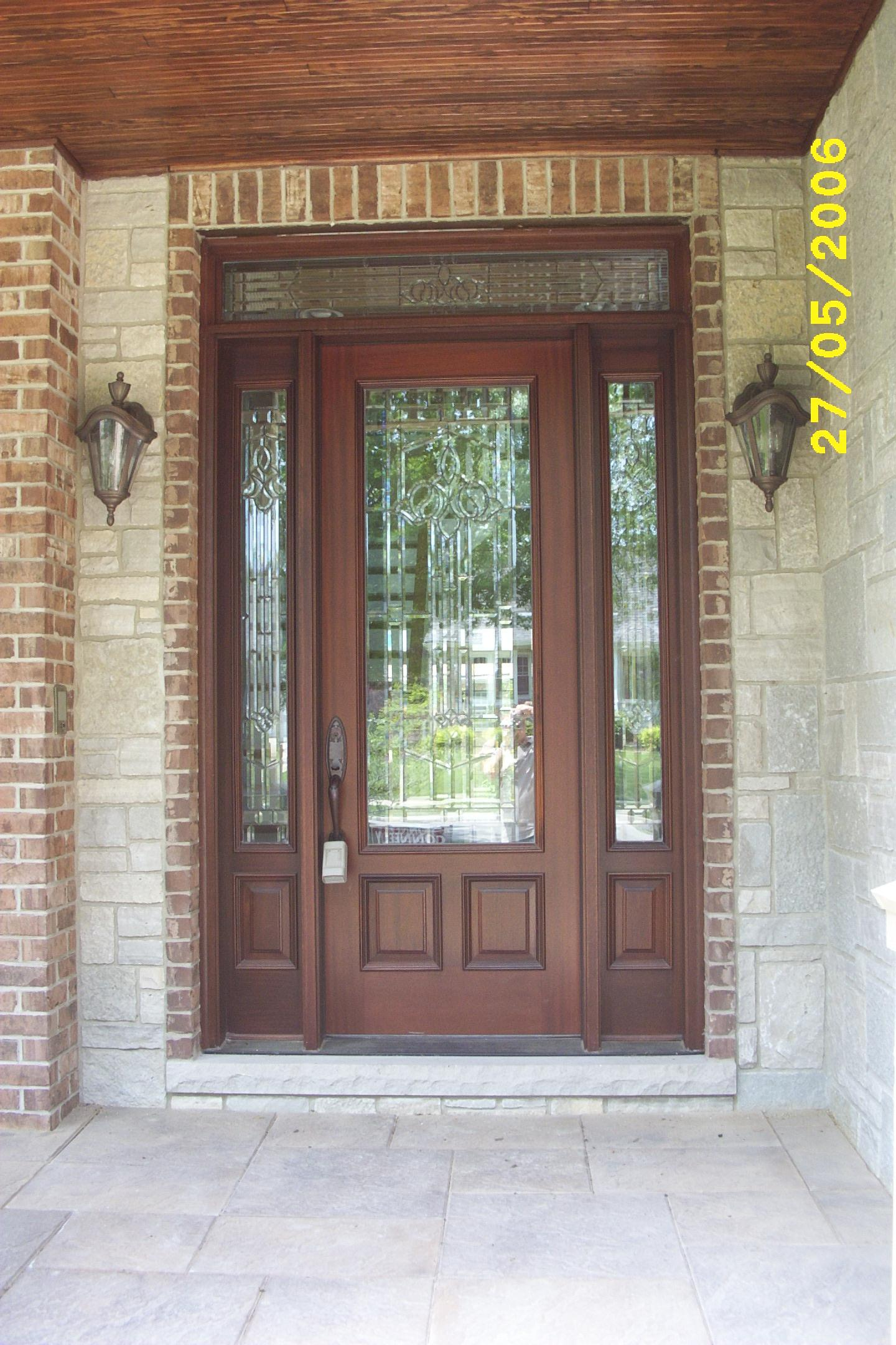 brown therma tru entry doors with handlecet handle matched with brick wall ideas