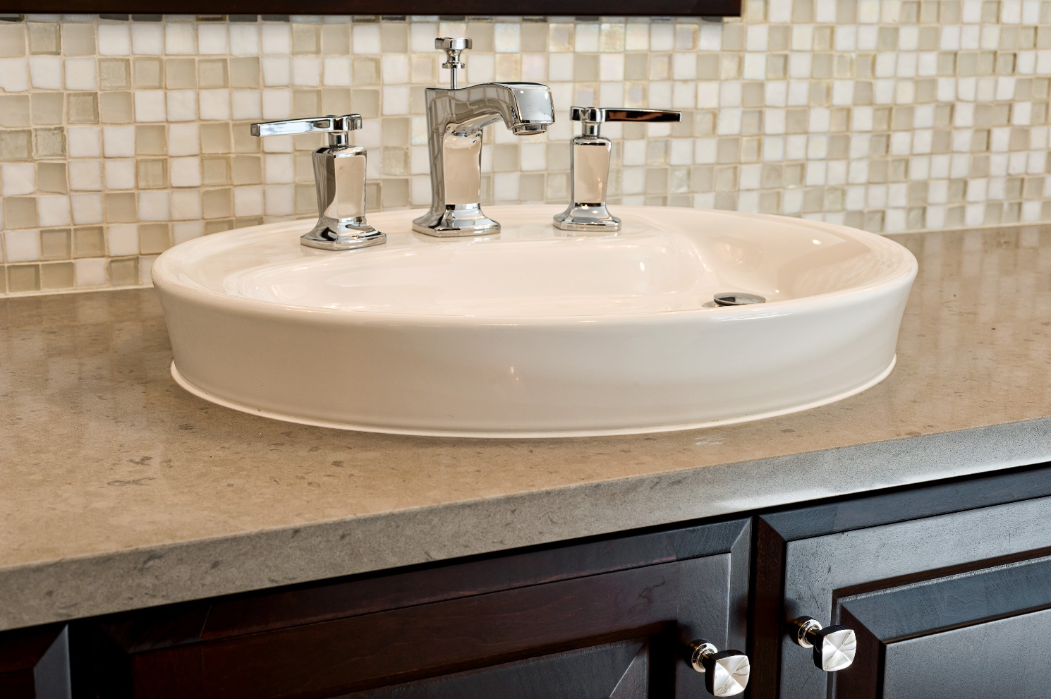 Caesarstone countertop with white sink and faucet plus mosaic tile back splash for bathroom decor ideas