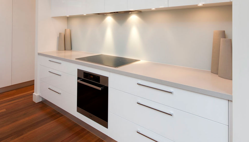 Caesarstone Natural Granite in white for countertop with storage and oven matched on wooden floor for kitchen ideas