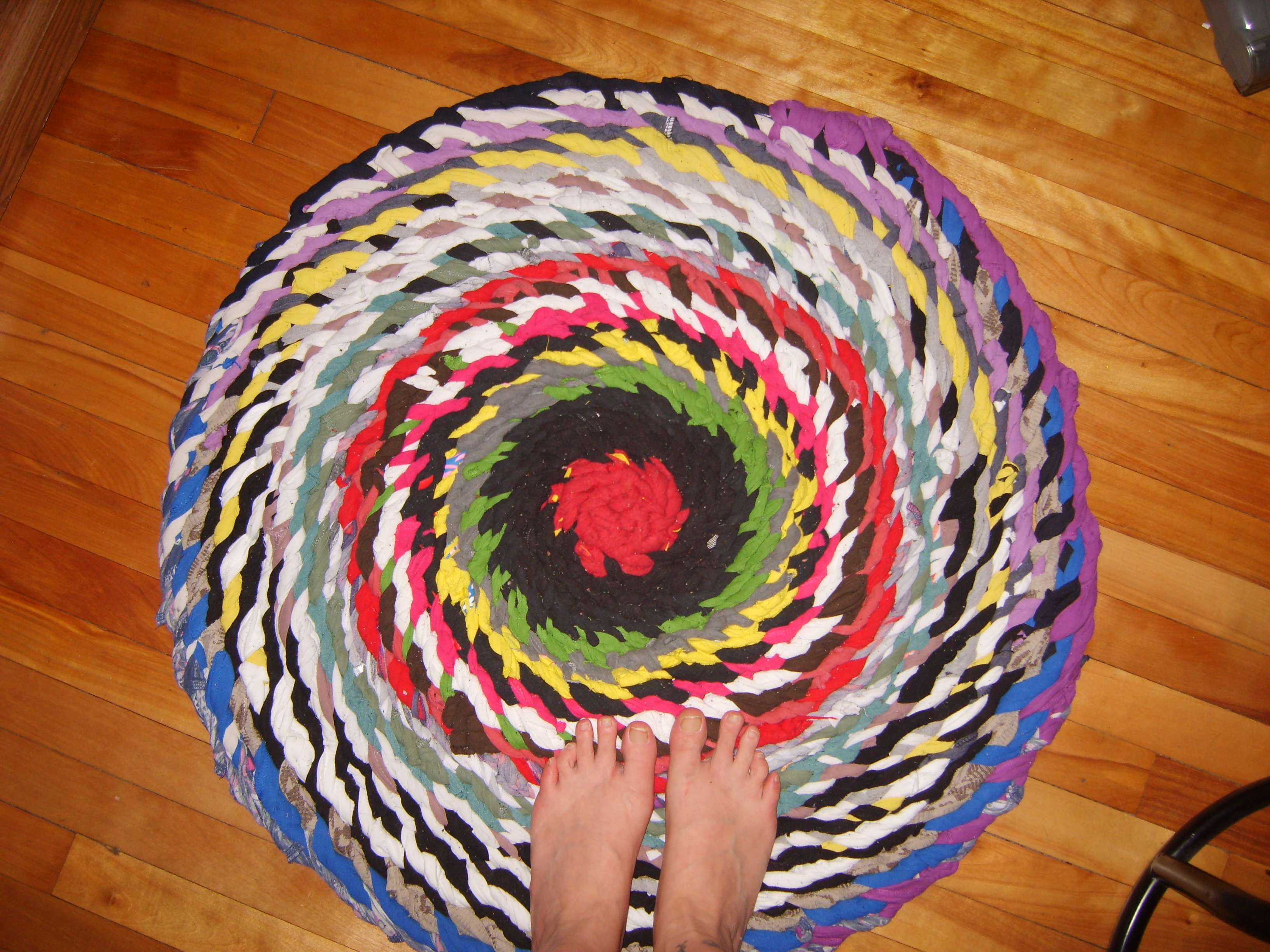 charming and colorful round braided rugs on wooden floor for floor decor ideas