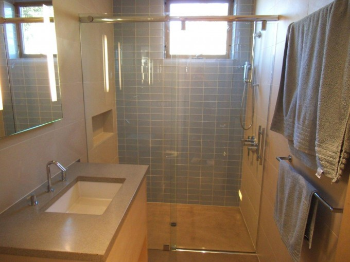 Charming Bathroom With Frameless Shower Doors Plus Silver Shower Faucet Plus Sink And Mirror Plus Window