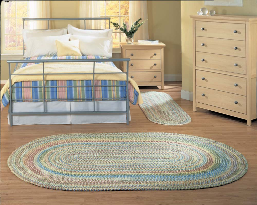 charming bedroom decoration with big oval multicolor Braided Rugs and bed plus dresser on wooden floor ideas