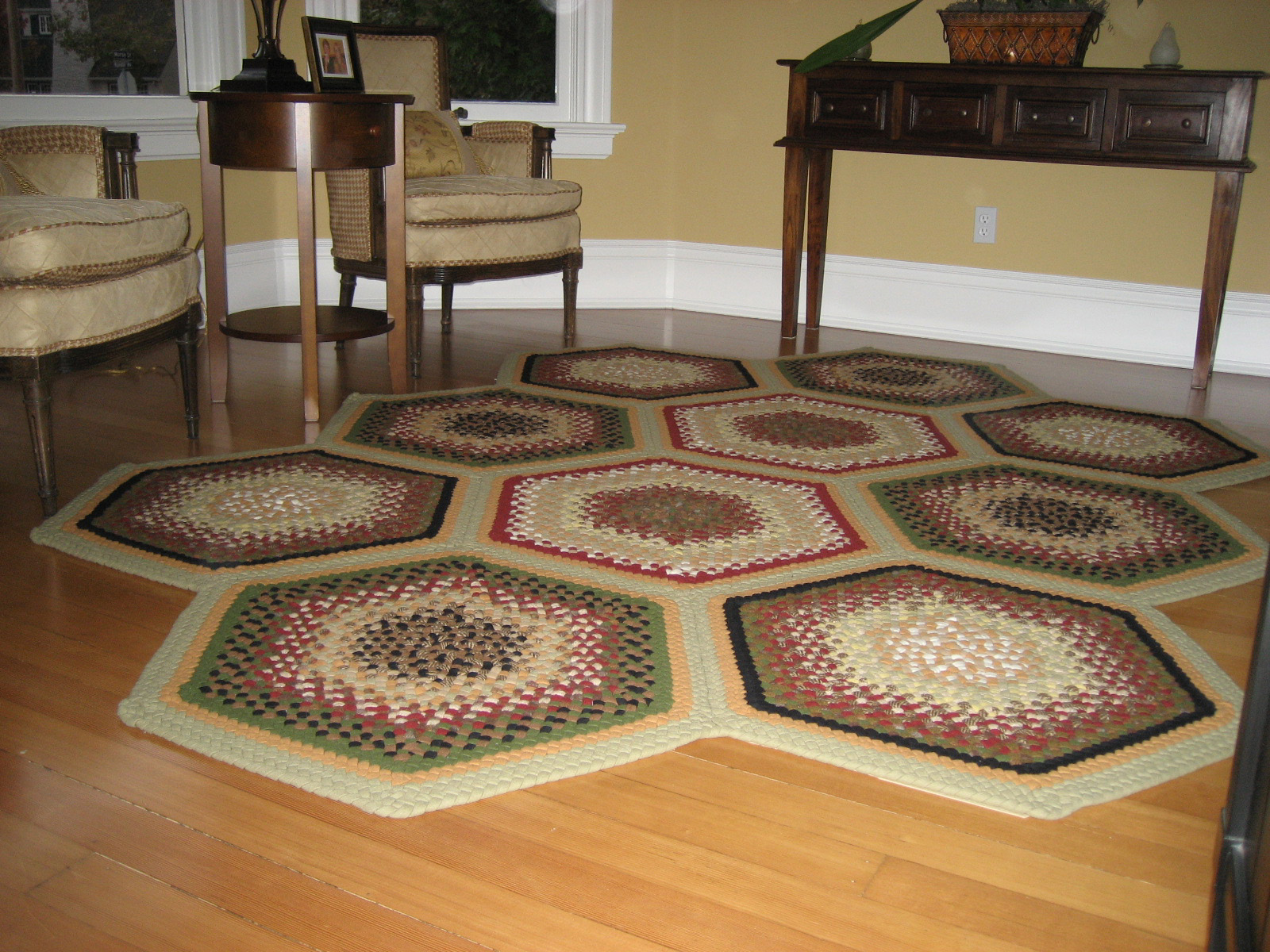 charming Hexagonal Braided Rugs in multicolor on wooden floor makes family room look more beautiful