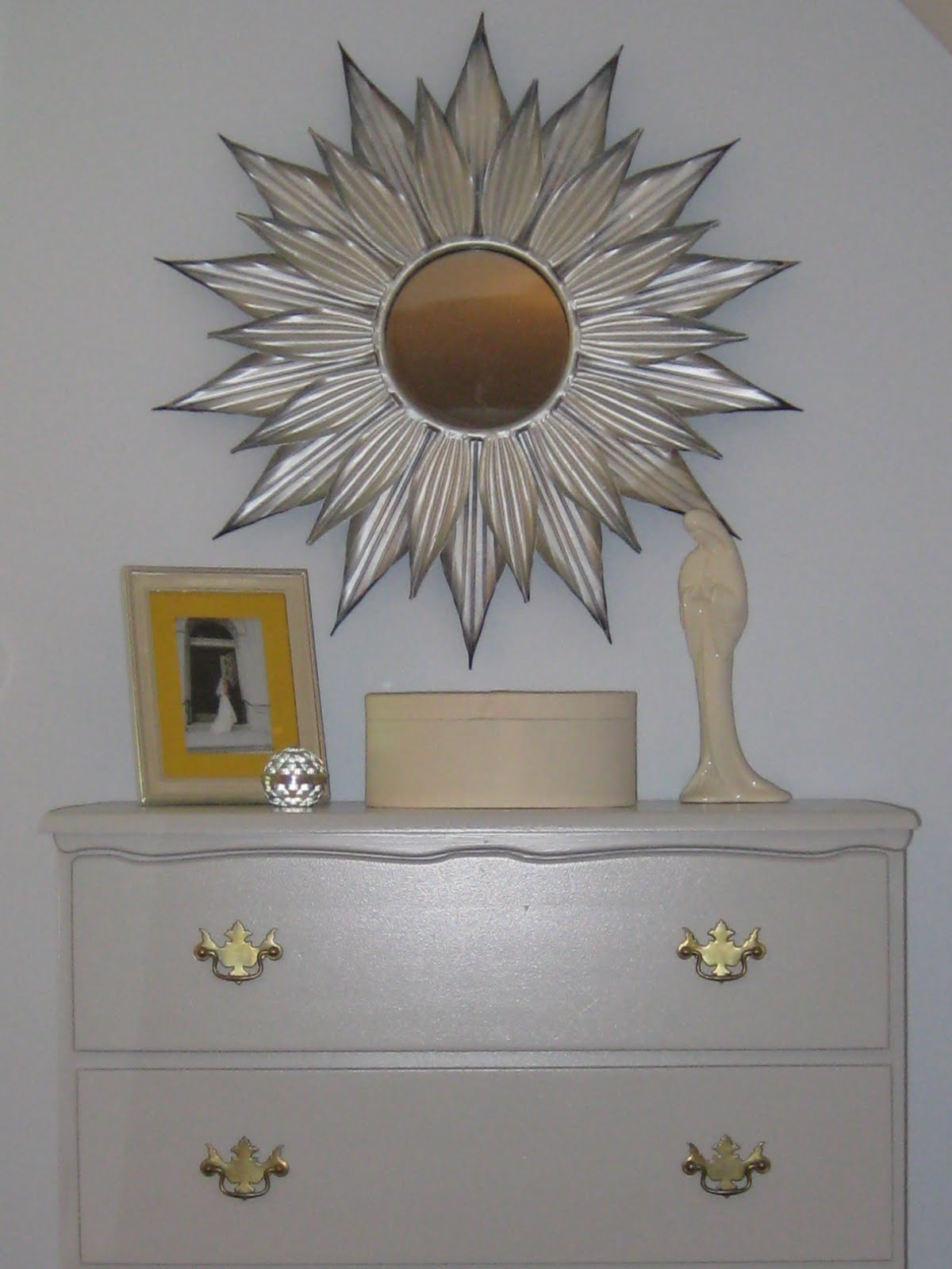 charming starburst wall decor with mirror on white wall plus dresser and picture frame ideas