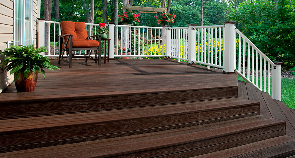 chocolate evergrain decking matched with white railing plus chair with orange seat ideas