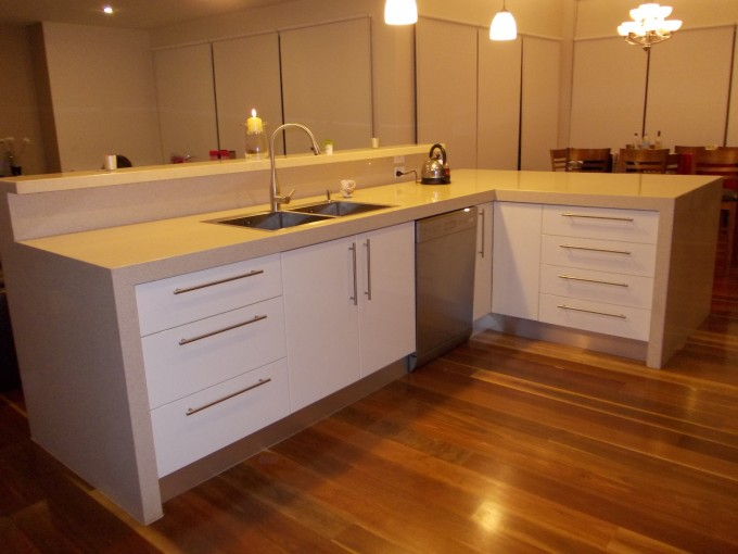 Cream Caesarstone Countertop With Sink And Faucet Plus Cabinet With Silver Handle On Wooden Floor For Bathroom Decor Ideas