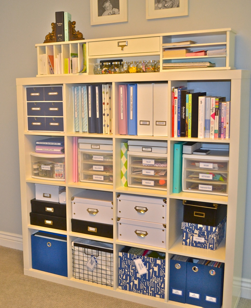 Cream Ikea Expedit Bookcase filled with book and other things ideas with grey wall and tan wall
