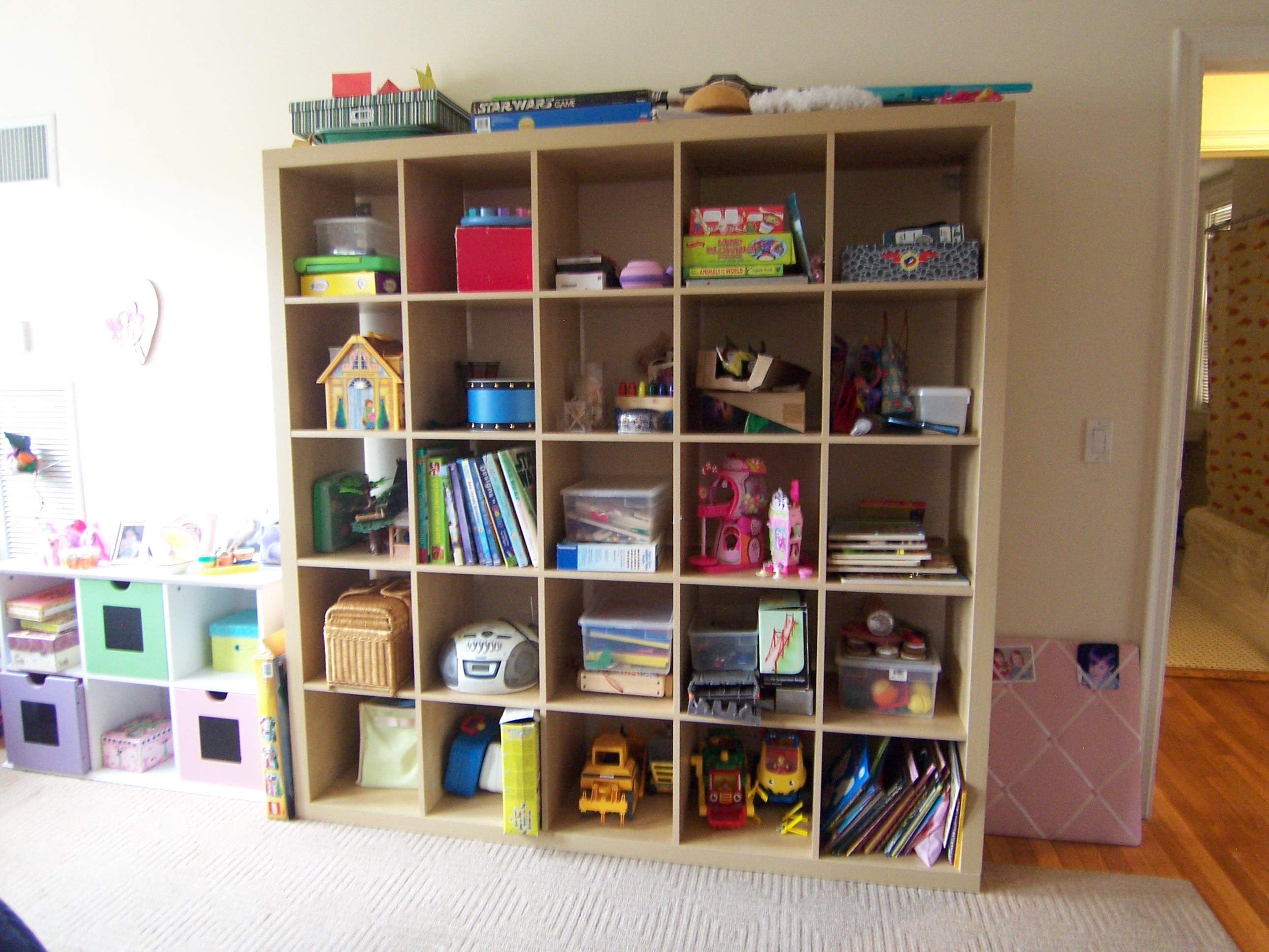 cream Ikea Expedit bookcase filled with books and toys ideas