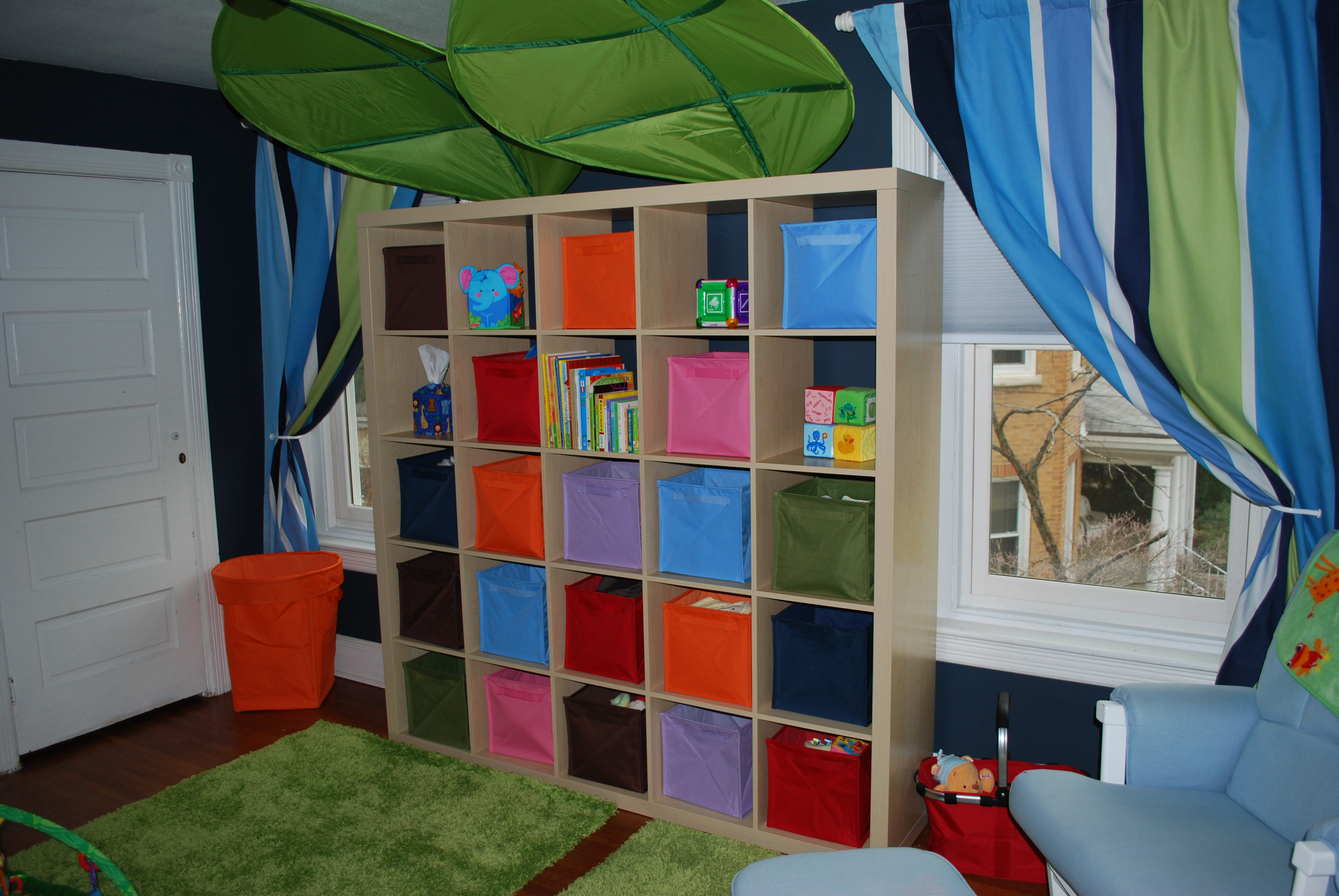 cream IKEA Expedit Bookcase with colorful boxes ideas with green carpet and blue curtains with vertical stripped