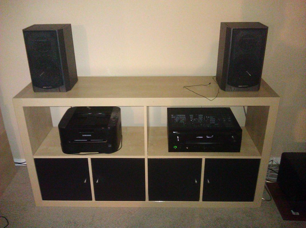 cream ikea expedit bookcase with tv stand and storage plus speakers and dvd player