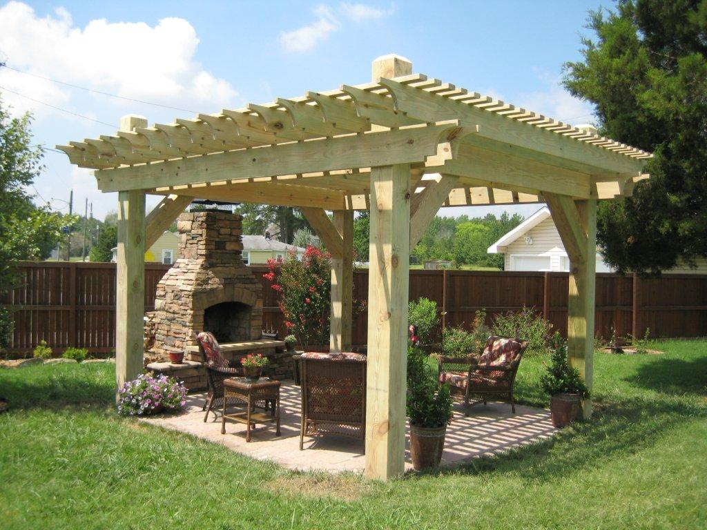 cream Pergola plans ideas with fireplace and chairs plus flowers