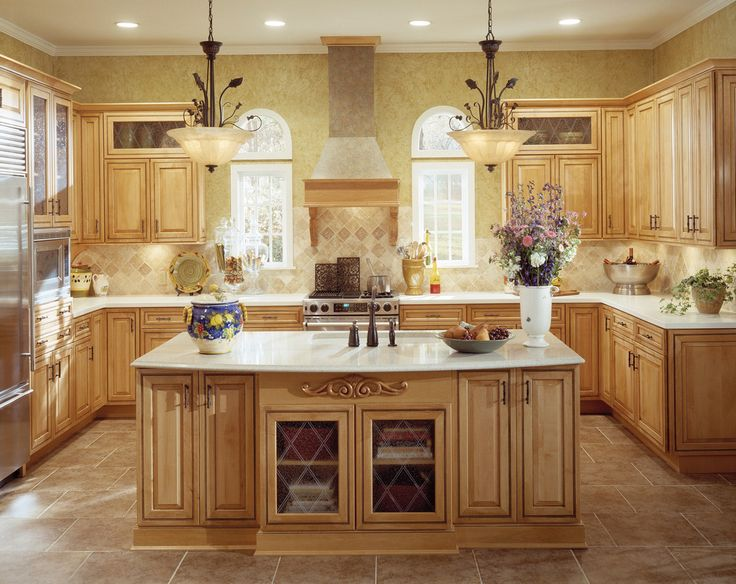 cream Thomasville Cabinets with white countertop and oven plus chimney for kitchen decoration