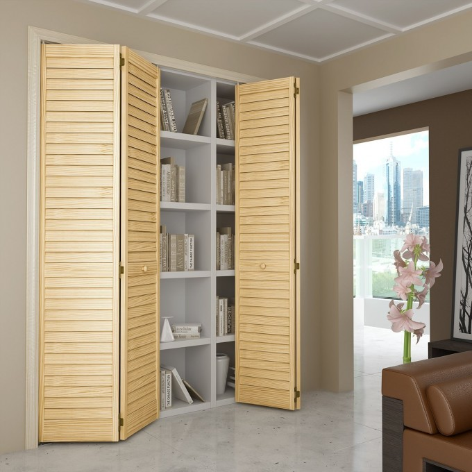 Cream Wooden Folding Closet Doors On Wheat Wall Filled With Books With Ceramics Floor Plus Sofa