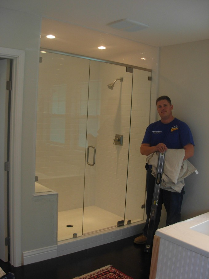 Custom Frameless Shower Doors Matched With White Wall Plus Silver Shower Faucet