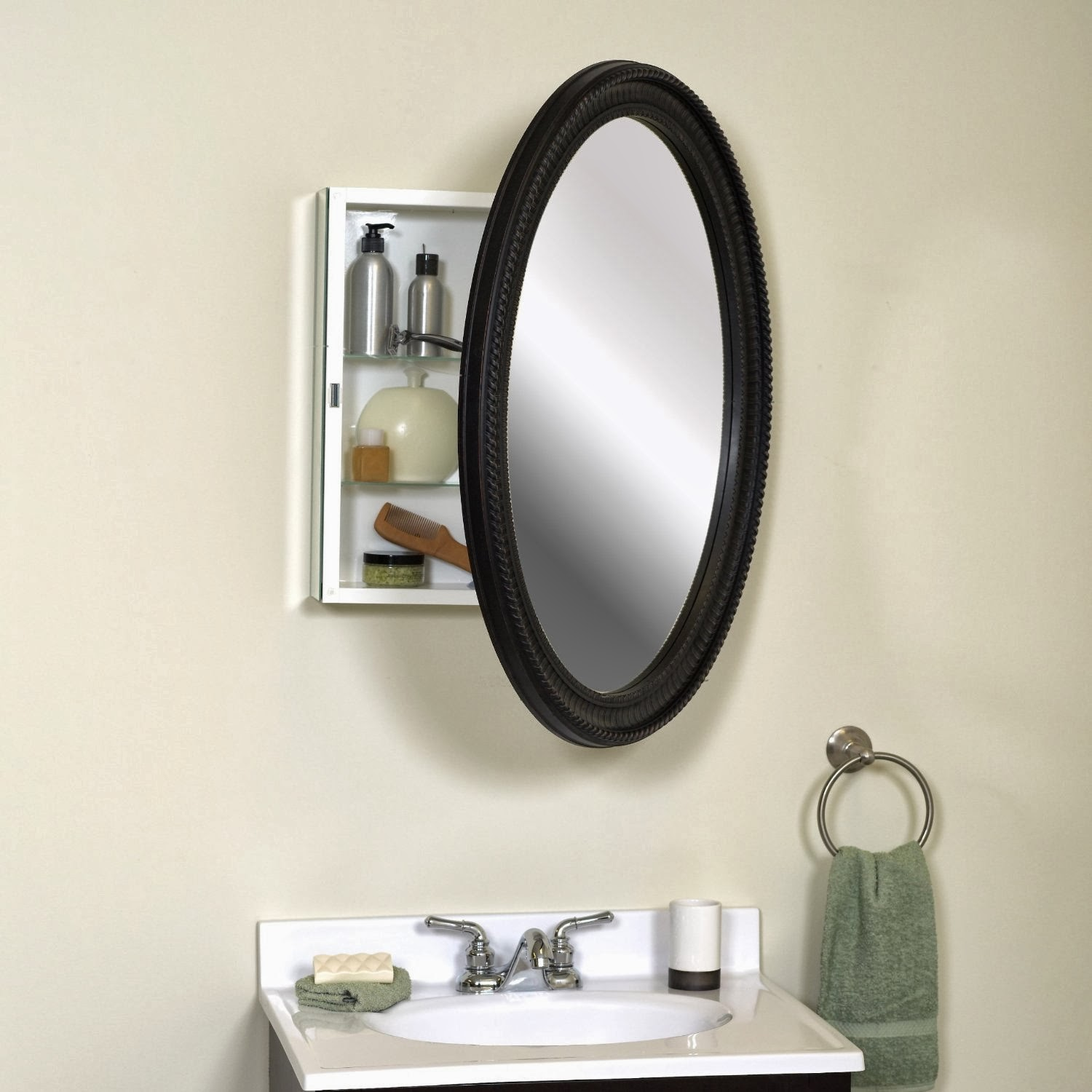 Custom lowes Medicine Cabinets plus black oval mirror and white sink with silver faucet on bathroom with white wall