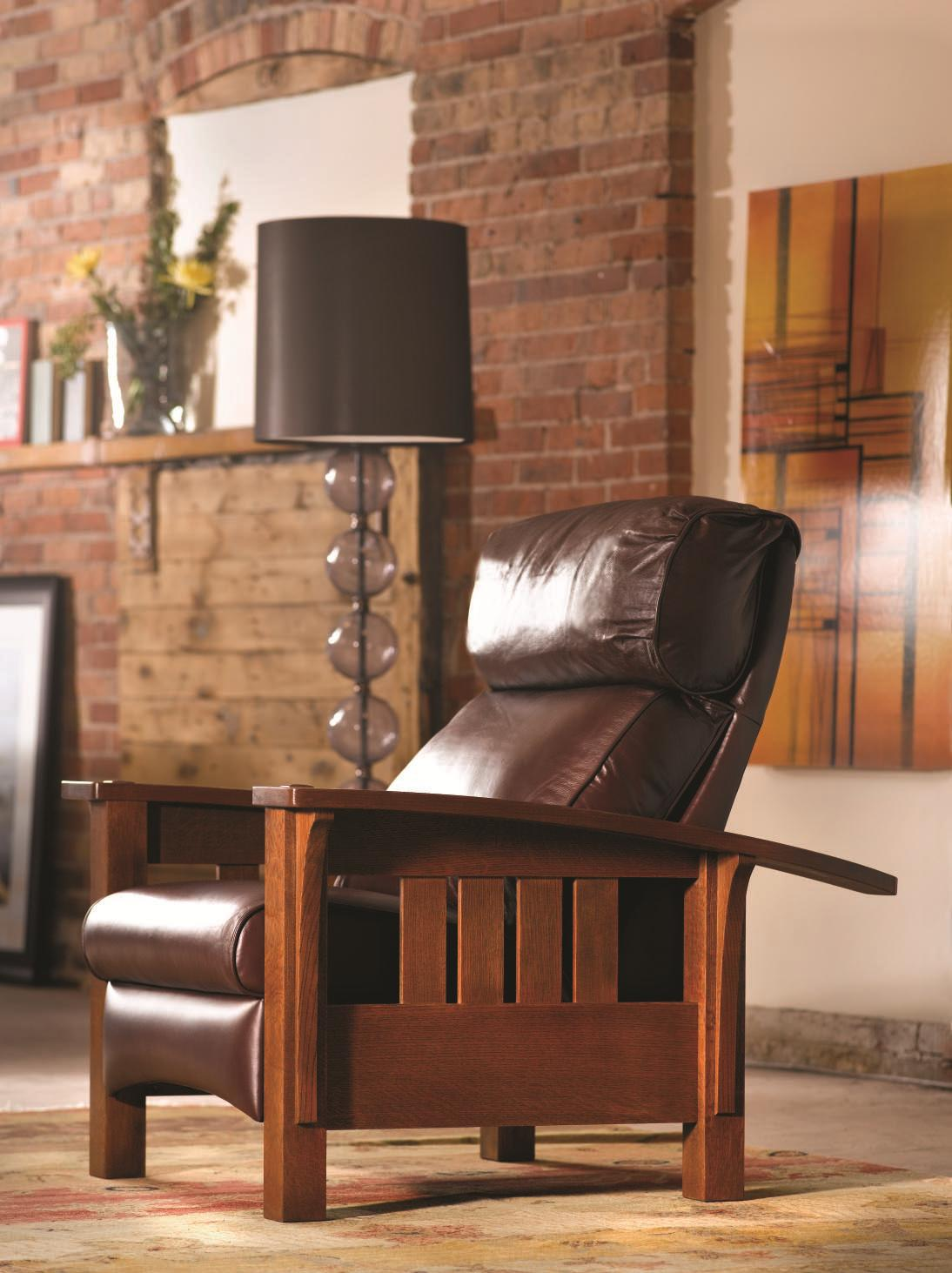 darkbrown leather single sofa by Sprintz Furniture on multicolor carpet plus floor standing lamp ideas