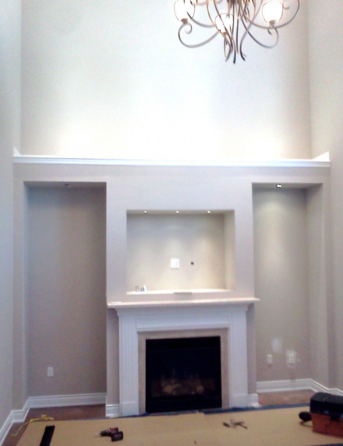 Eco Efficiency Montigo Fireplace Matched With White Wall And Wooden Floor
