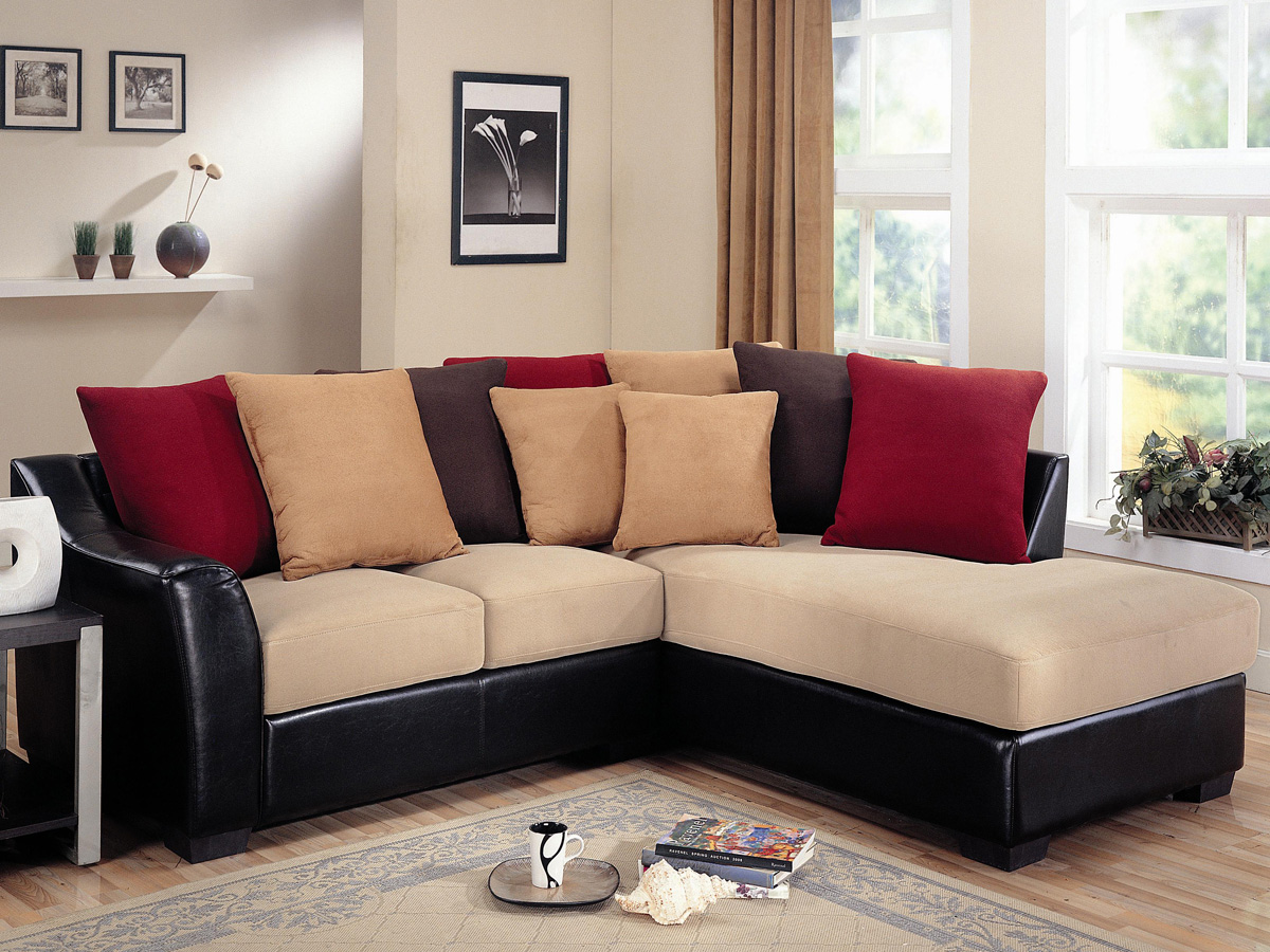 elegant black Sectional Couches with ream seat plus multicolor cushions on wooden floor plus carpet matched with cream wall for inspiring family room decor ideas