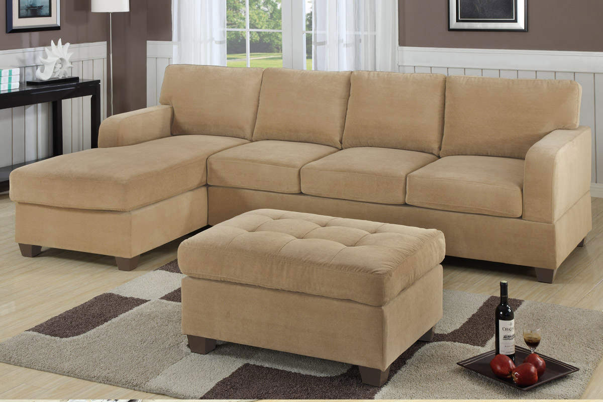 elegant l shaped cream Sectional Couches on wooden floor plus carpet matched with brown wall with wainscoting for charming living room decor ideas