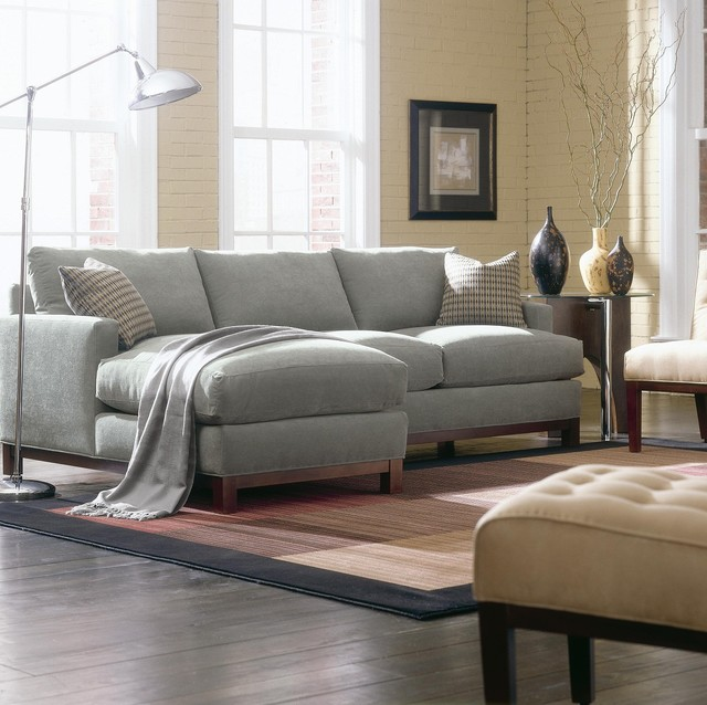 elegant small grey Sectional Couches on wooden floor plus carpet and floor standing lamp for inspiring fail room decor ideas