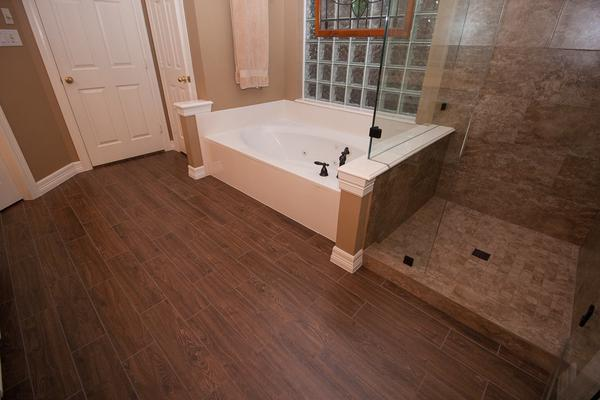 emser tile flooring plus white bath up and frameless shower door for bathroom ideas