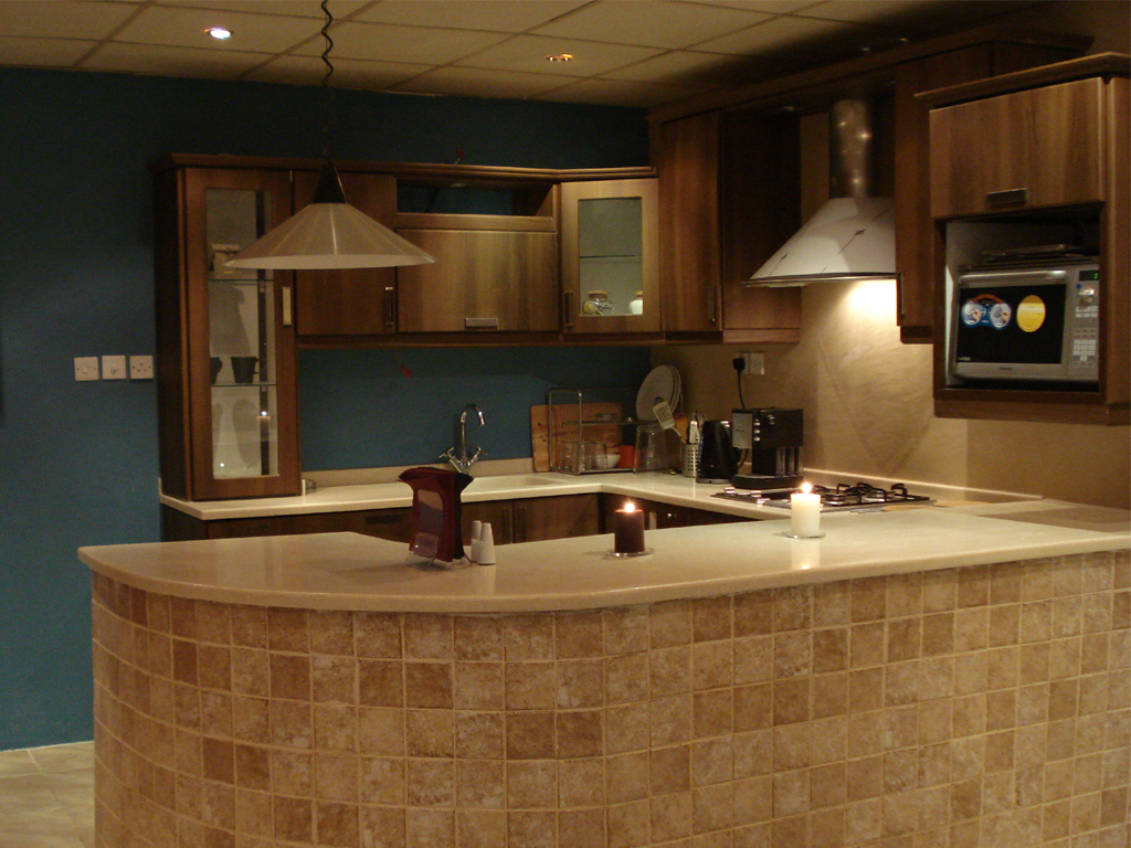 Excellent Kitchen Cabinet Refacing Ideas for Your Kitchen With slove and chandelier and blue wall