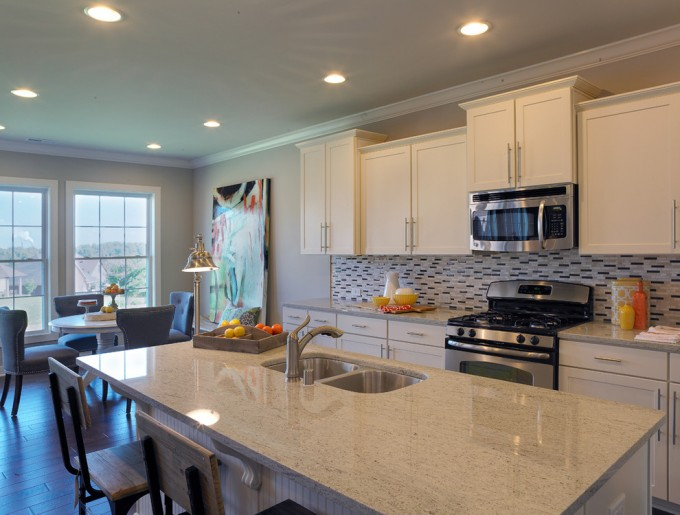 Fascinating White Aristokraft Cabinets With Mosaic Tile Back Splash And White Countertop Plus Oven And Sink For Kitchen Decor Ideas