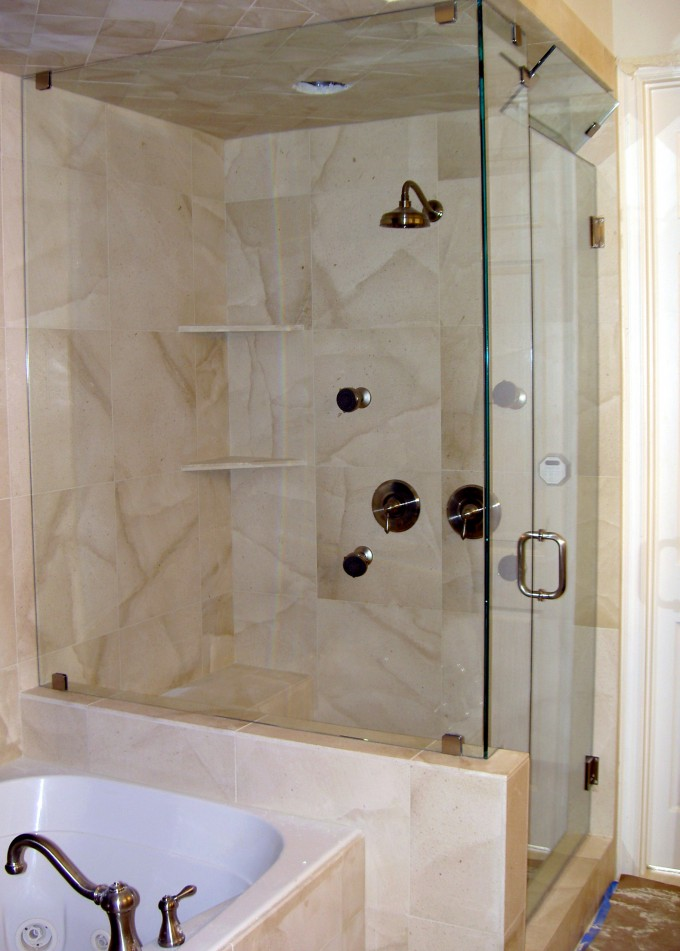 Frameless Shower Doors Look Great With Silver Handle Matched With Tan Wall Plus Brown Shower Faucet