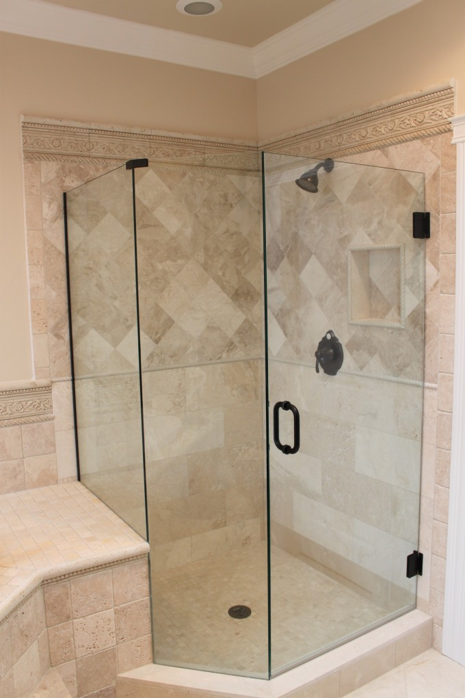 Frameless Shower Doors With Black Handle Matched With Tan Wall And Black Shower Faucet For Bathroom Ideas