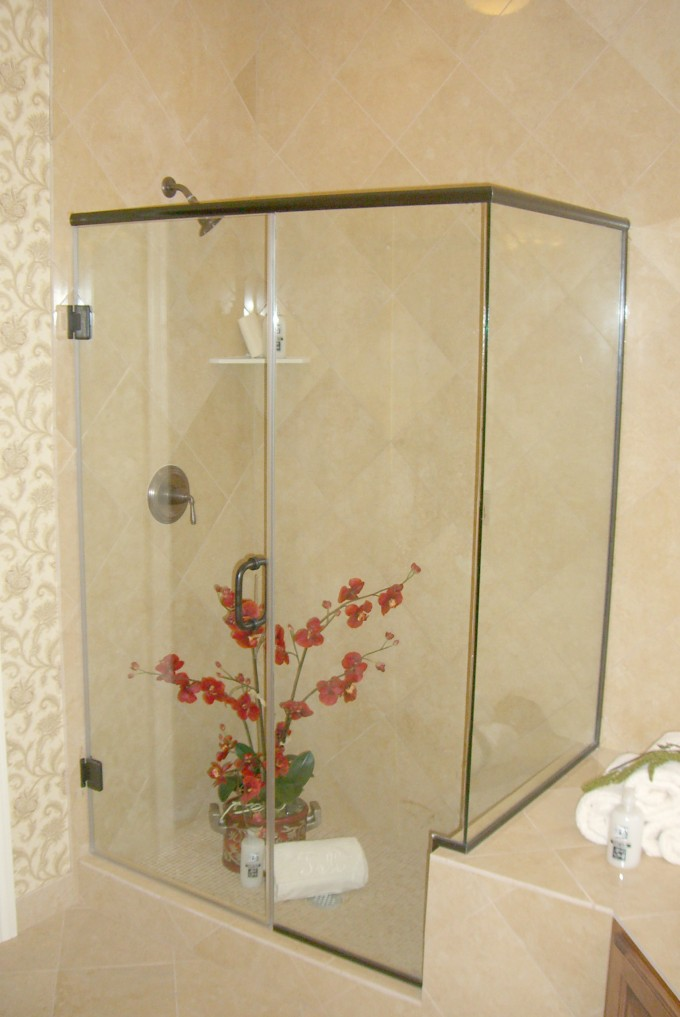 Frameless Shower Doors With Shower Faucet With Cream Wall Plus Flowers