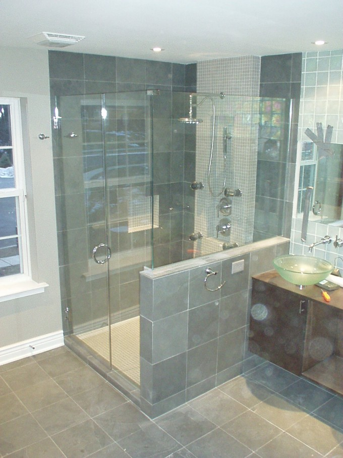 Frameless Shower Doors With Silver Handle Matched With Gray Ceramics Wall Plus Silver Shower Faucet And Mirror For Bathroom Ideas