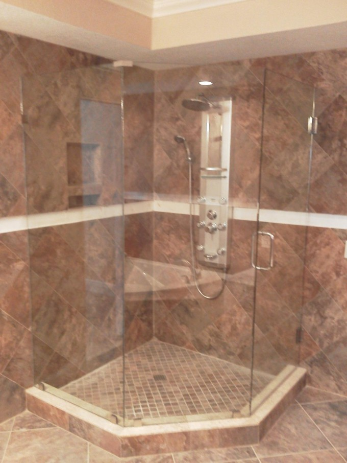 Frameless Shower Doors With Silver Handle Matched With Peru Wall Plus Silver Shower Faucet