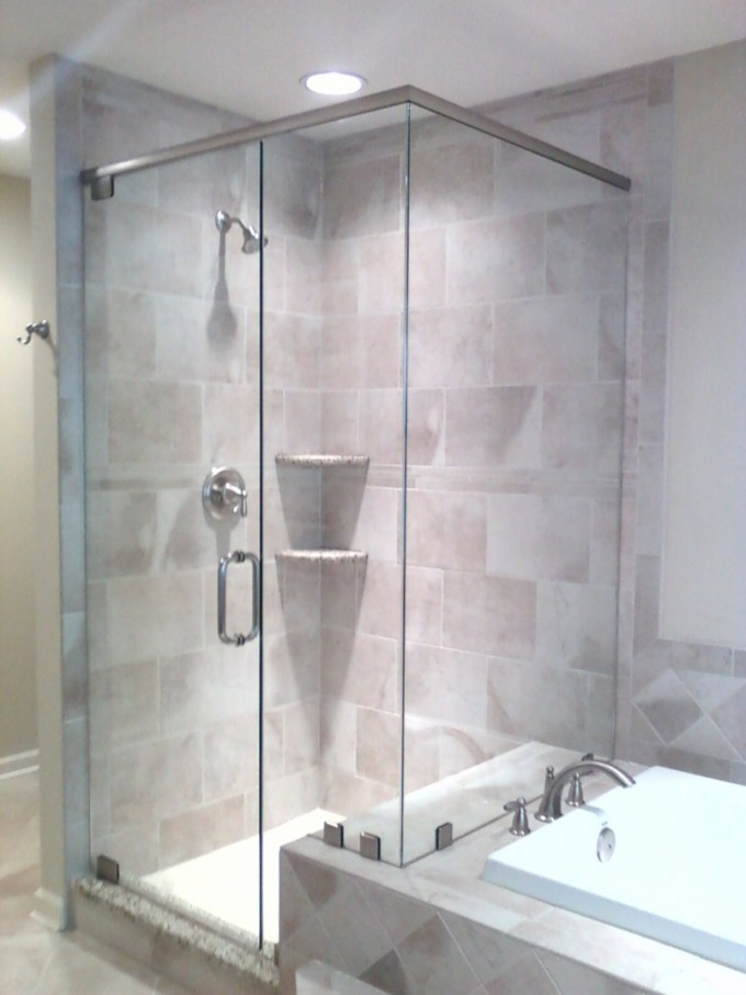 Frameless Shower Doors With Silver Handle Matched With Wheat Wall Plus Silver Shower Faucet Plus White Sink