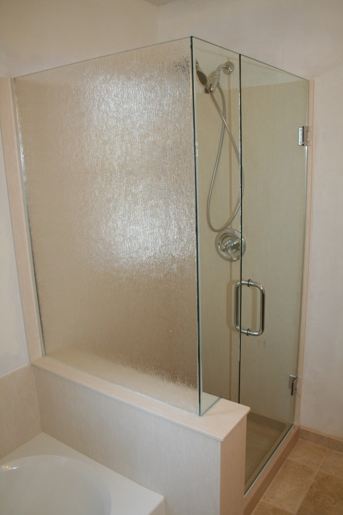 Frameless Shower Doors With Silver Handle Matched With White Wall Plus Silver Shower Faucet