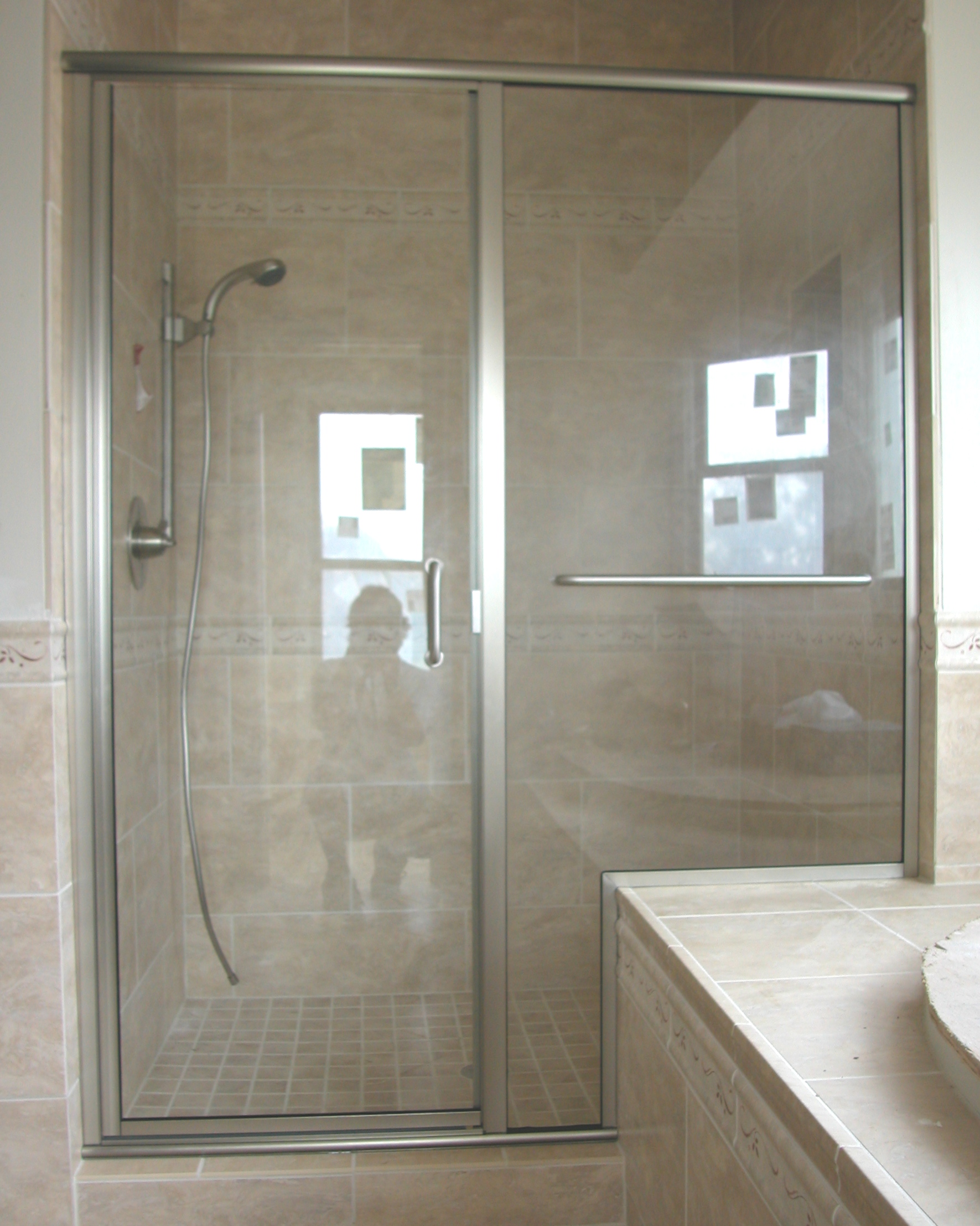 Frameless Shower Doors With Silver Handle Plus Silver Towel Hanger Matched  With Wheat Wall