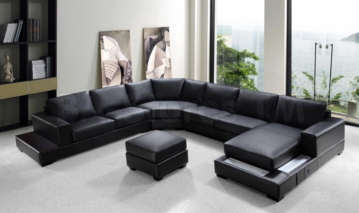 Fresh Modern Black Leather Sectional Couches On White Floor Matched With White Wall For Living Room Decor Ideas