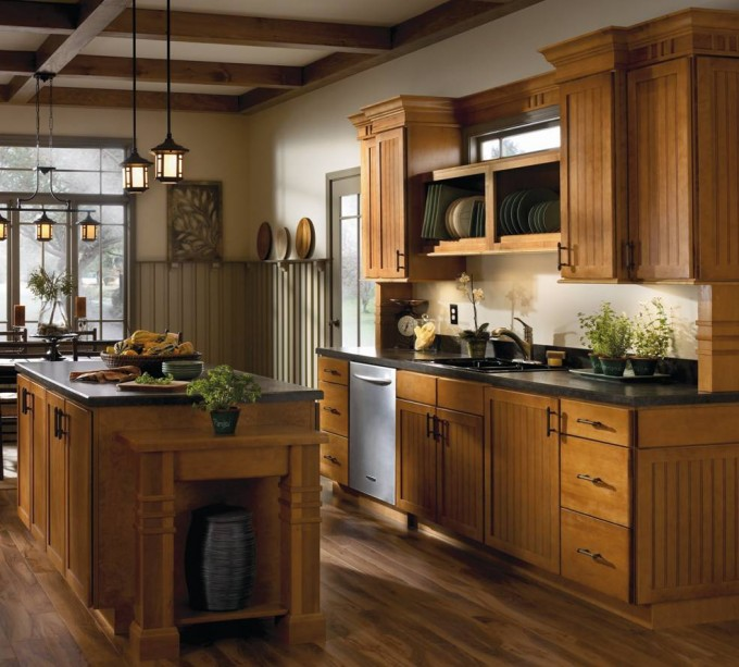 Goldenrod Aristokraft Cabinets With Black Countertop Plus Sink And Wooden Floor For Kitchen Decor Ideas
