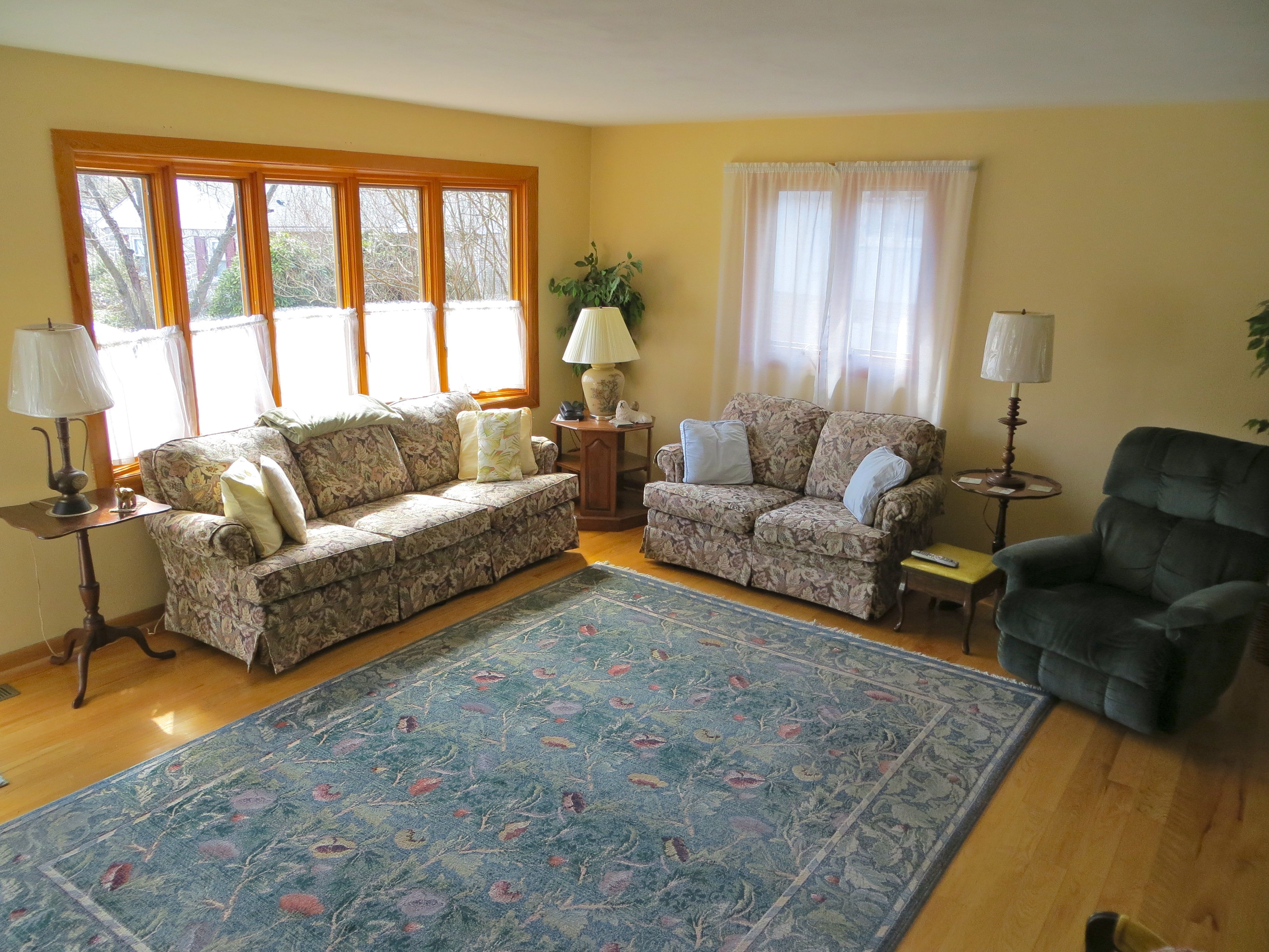 goldenrod pella windows matched with khaki wall plus sofa set with floor standing lamp ideas