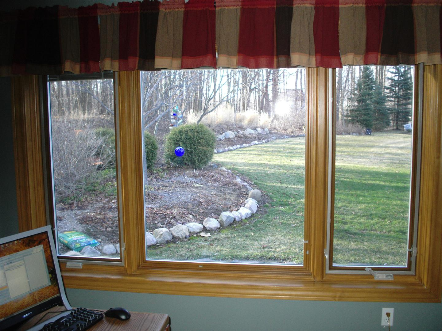 goldenrod pella Windows with horizontal stripped curtain plus blue wall for home decor ideas