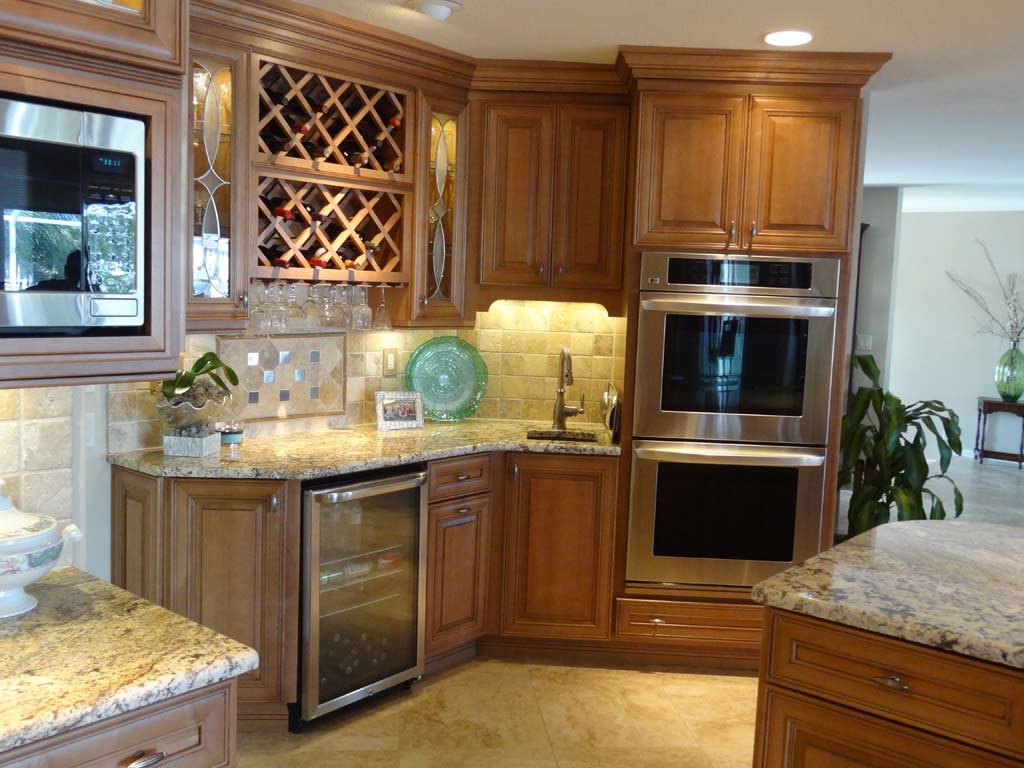 goldenrod wood Thomasville Cabinets with tile countertop and oven plus sink for kitchen decor ideas