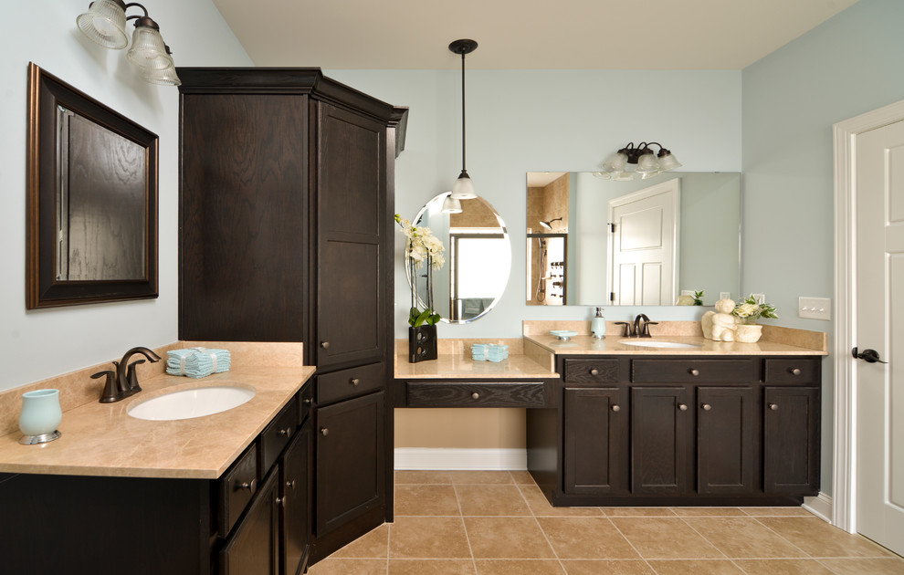 Gorgeous dark brown Aristokraft Cabinets With cream countertop and sink plus mirror for bathroom furniture ideas