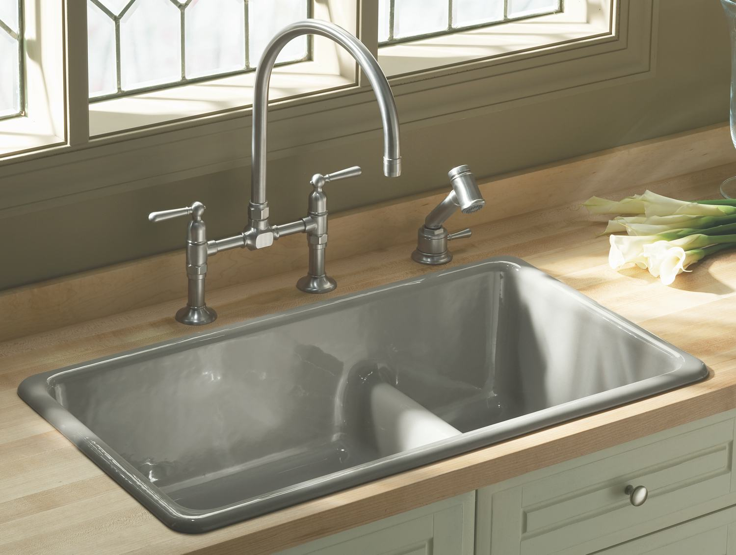 gray kohler sinks with silver bridge faucet plus kitchen cabinet with cream countertop ideas