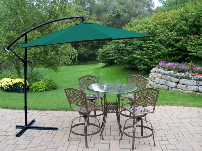 Green Cantilever Umbrella With Black Stand Plus Outdoor Dining Table For Back Yard Ideas