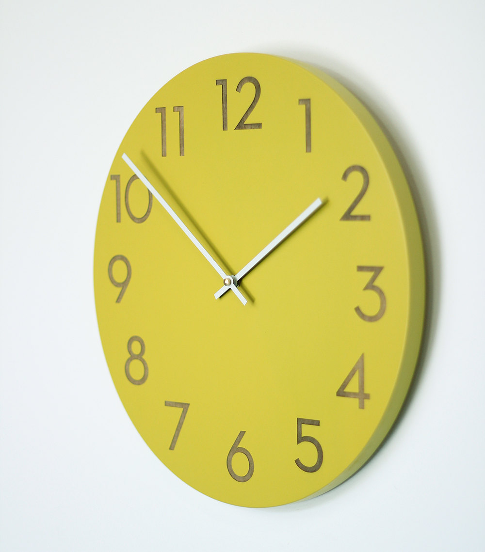 green oversized wall clock with white hand
